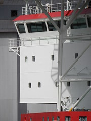 Bridge Adventure (Nekoglyph) Tags: bridge windows shadow red white industry lines metal river grey boat dock ship vessel warehouse middlesbrough teesside windfarm tees helipad jackup mpiadventure