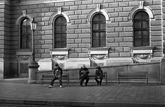 Altix V - Newspaper Readers (Kojotisko) Tags: street city people bw streets person czech streetphotography brno cc creativecommons czechrepublic streetphoto persons rodinal selfdeveloped altix altixv