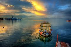 Peaceful (Nejdet Duzen) Tags: travel sunset reflection turkey boat cloudy trkiye sandal warship izmir gnbatm yansma turkei seyahat bulutlu inciralt savagemisi