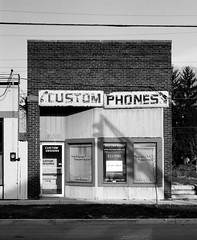 custom phones (jsrice00) Tags: bw film analog indianapolis indiana explore storefront leicam3 50mmf2summicron
