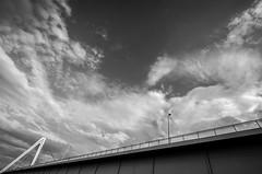 bridge under troubled sky (Blende1.8) Tags: bridge clouds river germany deutschland fuji cologne wolken kln fujifilm brcke fluss rhein fujinon rheinbrcke severinsbrcke wolkenhimmel xt1 severinsbruecke 1024mm carstenheyer