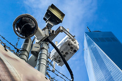 Barbed Wire, Security Cameras, and The Freedom Tower (Josh Munson) Tags: camera nyc newyork america fence freedom surveillance center security wtc protection worldtrade