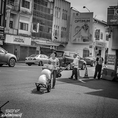 Street photography-Monochromatic (Helmiyousif) Tags: life street travel sky people blackandwhite bw woman white abstract man black streets reflection men art cars monochrome buildings photography landscapes photo women faces photos walk background homeless stock cities culture traditions lifestyle monochromatic tourists elderly roads items microstock coubles