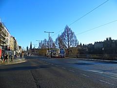 Edinburgh (View along Princes Street) (Netty 78) Tags: road street old city blue trees winter sky people urban bus buildings scotland edinburgh europe european cityscape britain centre united union capital great tram kingdom historic princes lothian 2015