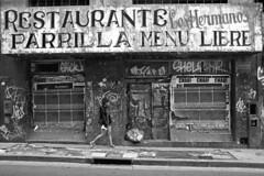 Argentina - Buenos Aires (luca marella) Tags: road street old city urban bw white black girl america walking restaurant blackwhite decay documentary social pb bn bianco nero santelmo reportage marellaluca