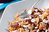 Bowl of organic muesli (Vegan Photo) Tags: morning food breakfast healthy raw natural wheat grain cereal nuts dry spoon bowl raisins oatmeal health meal vegetarian almonds organic dried diet fiber flakes granola oats cornflakes crunchy oat nutrition musli muesli wholegrain