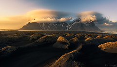 Vesturhorn lenticulars (Ron Jansen - EyeSeeLight Photography) Tags: ocean winter light sunset cloud black beach grass clouds lava iceland sand waves glow cloudy dunes south dune wave peak wideangle east peaks lenticular depth austurland vestrahorn d810 stokksnes vesturhorn eyeseelightphotographyronjansen