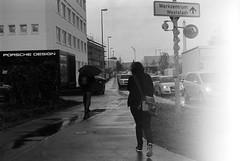 white heat returned (all the bulbs are spent...) Tags: street rain rainyday streetphotography cranes lightleak sidewalk constructionsite ludwigsburg leicam6 wetpavement stihl porschedesign badenwuerttemberg kodaktrix400 lotter voigtlandernokton50mmf15 werkzentrumwest robertboschstartup gaensfussallee groenerstrasse