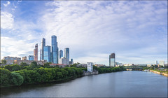 Russia. Moscow. Moscow-City. (Yuri Degtyarev) Tags: leica city water skyline skyscraper river t skyscrapers cloudy russia outdoor moscow ciudad stadt russian moskau embankment mosca ville federation moscowcity graduated density citt moscou neutral   cokin mosc   p120    moskova 23mm ehir        summicront gnd33 typ701
