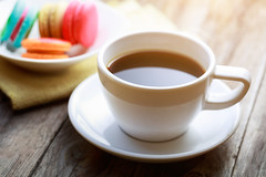 Cup of coffee and coffee (Krunja) Tags: wood old morning food brown white black france hot color cup kitchen coffee up closeup modern breakfast vintage dark french table wooden cafe colorful close flavor natural drink background space traditional rustic beverage style fresh biscuit cups mocha foam snack mug croissant espresso taste caffeine cappuccino saucer macaroons