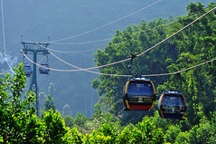 Mountain lifeline (Roving I) Tags: travel mountains tourism transport vietnam jungle infrastructure attractions danang cablecars banahills