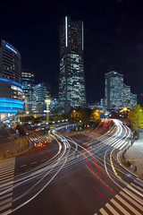 Night view of Yokohama Minato Mirai (DigiPub) Tags: street city longexposure japan vertical modern night skyscraper outdoors photography crossing traffic citylife wave officebuilding business nightview yokohama onsale minatomirai development  japaneseculture taillight gettyimages zebracrossing citystreet lighttrail   motorvehicle traveldestinations famousplace buildingexterior yokohamalandmarktower internationallandmark landvehicle tallhigh 528049393 g14155671 p20141115 o20141212