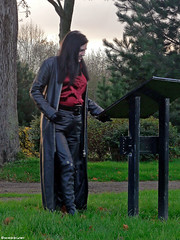 Woman with a Leather Coat - 2/6 (Mistress Maggie dot com) Tags: red woman black public leather lady female fetish standing outdoors belt shiny pants boots coat longhair blouse jeans gloves mature trousers satin knee mistress blackhair domme leder belted