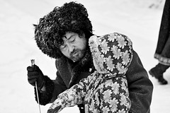 Caring Cossack (Ktoine) Tags: people blackandwhite bw eyes child russia cossack help sword care kneeling enacting