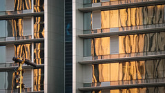 Golden Reflections (Theen ... busy) Tags: windows light white buildings reflections gold golden opposite samsung cctv adelaide streaks victoriasquare molten lateafternoon theen