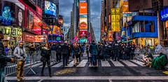 Pause  ll (Gordon McCallum) Tags: nyc newyork neon sony nypd streetscene tourist timessquare sigmaartlens sonya6000