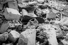Ancient shoes (Frostroomhead) Tags: blackandwhite white black art nikon shoes f14 bricks sigma 30mm d5200