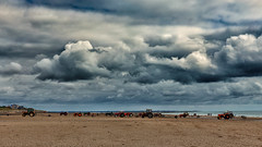 Oyster Tractors (Hugh Rawson) Tags: clouds france sky stgermainsuray normandy beach tractor cloud
