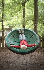 Swing (TW...) Tags: swing boy inverse upside down laying park play playing swinging trees circle