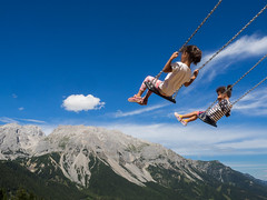 Full of Joy (Mahmoud Abuabdou) Tags: kid kids child children play playground swing high mountain cloud blue sky alp alps rittisberg steiermark austria sterreich exposure aperture fun joy beautiful interesting olympus omd em1 wide nature landscape green light fast shutter summer