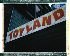 Retailer of Misfit Toys ([jonrev]) Tags: lakeland variety 510 toy store toyland retail signage minocqua wisconsin united states northwoods tourist spot signs polaroid 195 instant film land camera color fuji fp100c tiffen 812 warming filter