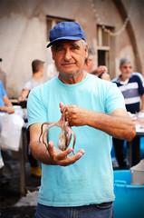 Faces of Piscaria, Catania's fish market (ciccioetneo) Tags: catania sicilia sicily italia italy piscaria fishmarket pescheria folklore nikond7000 ciccioetneo apiscaria nikon50mmf14 upuppu polpo street photography