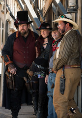 The Steampunk Travelers Arrive (thePhotographerRaVen) Tags: steampunk tucson oldtucson arizona wwwc wwwc5 wildwest fantasy goggles beautiful woman gentlemen cowboy hats photobyraven