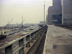 Lower Manhattan in the good old days. Looking up the abandoned West Side Highway in front of the World Trade Center. West Street, Battery Park City landfill and abandoned Hudson River piers at left. New York. March 1975 (wavz13) Tags: oldphotographs oldphotos 1970sphotographs 1970sphotos oldphotography 1970sphotography vintagesnapshots oldsnapshots vintagephotographs vintagephotos vintagephotography filmphotos filmphotography historicphotographs historicphotos historicphotography newyorkphotographs newyorkphotos oldnewyorkphotography oldnewyorkphotos vintagenewyorkphotography vintagenewyorkphotographs vintagenewyorkphotos oldworldtradecenter vintageworldtradecenter twintowers originalworldtradecenter 110film kodacolor analogphotography instamatic pocketinstamatic oldhighways vintagehighways manhattanskyline newyorkskyline newyorkskyscapers manhattanhistory newyorkhistory 1970smanhattan 1970snewyork oldnewyork vintagemanhattan oldmanhattan 1970scars 1970scar oldcars oldcar 1970shighways 1970shighway oldhighway rainy gloomy urban grain grainy vintagecars vintagecar 1960scar 1960scars