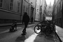 (giovanibr) Tags: salzburg austria street streetphotography kids skate vanishing point sun light children play time church tower bike bicycle