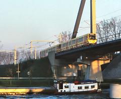 Once upon a time - The Netherlands - Utrecht Jutfasebrug (railasia) Tags: holland provinceutrecht utrecht jutfasebrug sun articulatedmotorcar doubletraction sig deliverydesign infra bridge eighties