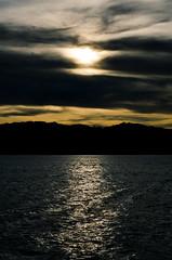 Sunset (Ng Shu Yuan) Tags: sunset sea mountain seascape reflection water beauty port landscape 50mm golden nikon jetty hill dramatic hour malaysia decisivemoment jesseltonpoint nikond7000