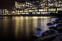 Lindholmspiren by night (leif varemo) Tags: city longexposure blue building water yellow architecture night buildings river gteborg rocks cityscape goth