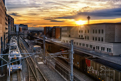 Sunset in town (JusDaFax) Tags: city sunset urban beautiful clouds train buildings colorado colorful tracks wallart denver rays