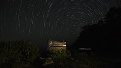 Star trails over Kewfin Viewpoint at Che Son National Park (Alongkot.S) Tags: park travel blue light red motion night dark landscape thailand star colorful long exposure natural outdoor horizon peak son clear trail national astrophotography thai western rotation starry chae geological kewfin