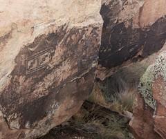 Petroglyphs at the Petrified Forest National Park - Arizona (Brynn Thorssen) Tags: park red arizona rain fossil nationalpark ancient rust flood cloudy desolate petrifiedforestnationalpark flooded petrifiedforest petrified petrifiedwood fossilized rainbowforest