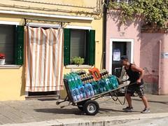 """A la force du poignet..."" (FloDL) Tags: venice italy water eau italia curtain acqua venise venezia wheelbarrow italie rideau faade burano brouette porteurdeau"
