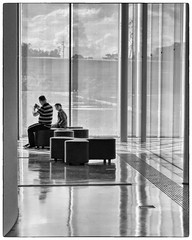 Reflection(s) (Eric@focus) Tags: man france reflection glass lens blackwhite child louvre daughter son parent fujifilm wondering 1000v40f neroamet distinguishedblackandwhite