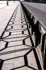 Cordoba stuck in patterns - Happy Fenced Friday! (lunaryuna) Tags: bridge fence shadows cordoba pedestrians andalusia lightshadow southernspain solsombra luanryuna guadalquivirriver hfffencefriday shadowfenceing