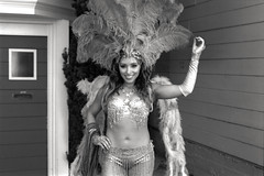 baubles, bangles and beads (Super G) Tags: blackandwhite bw woman film smile beads costume feathers dancer nikonn80 selfdeveloped ilforddelta100 d7611115min