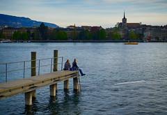 On the Pier in Geneva, Switzerland (` Toshio ') Tags: toshio geneva switzerland lakegeneva lacleman pier girls sitting oldgeneva swiss fujixe2 xe2 women lake water mountain europe european watertaxi paquis
