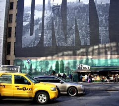 Liberty looks down on a New York street (nick taz) Tags: liberty newyork street taxi