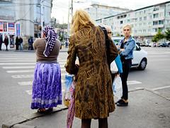 street scene, Cluj-Napoca (fotobardamu) Tags: street cluj romania transylvania sidewalk pedestrian car corner coat umbrella