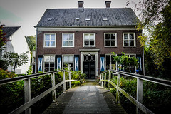 House with bridge @ Zeist (PaulHoo) Tags: vignette vignetting 2016 bridge zeist holland netherlands lightroom fuji x70 house architecture window symmetry