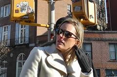 anonymous new york (omoo) Tags: newyorkcity girl graffiti streetlight hand streetscene blonde gesture greenwichvillage yellowstoplight greyglove dscn7149 anonymousnewyork bleeckerand7thavesouth