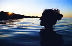 last days of summer (claudia.sajeva) Tags: sunset sea portrait sun water girl silhouette 35mm xpro saturated tramonto mare kodak crossprocess vivid rangefinder analogue sole elitechrome acqua ritratto eb ragazza filmphotography profilo yashicaelectro 35gt telemetro