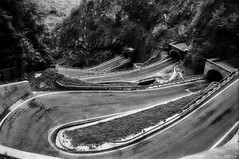 it's our way or the highway ... (lunaryuna) Tags: bw italy mountains architecture blackwhite pass monochromatic serpentines tunnels lunaryuna dolomites hairpins dolomitemountains passosanboldo itsallaboutmotion amazeingroad