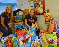 Nicole, Chelsea, and Megan help with the donation drive for the Humane Society.
