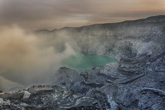 Crater of volcano Ijen. (Bugphai ;-)) Tags: mist mountains nature beautiful yellow rock stone danger sunrise indonesia landscape volcano java earthquake scenery day power view hole smoke acid scenic nobody steam gas crater valley mineral ash environment aggressive sulfur fracture volcanic vapour vapor eruption vulcano brimstone active fume seismic stink stench volcanology fumy lifeless fumarole jawatimur geophysics ijen banyuputih