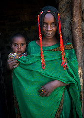 Afar tribe woman with her baby, Afar region, Erta ale, Ethiopia (Eric Lafforgue) Tags: africa portrait people woman baby haircut color vertical hair outdoors photography women child adult african muslim islam mother tribal bead shawl ethiopia ethnic hairstyle 2people twopeople beaded beautifulpeople braid braided hornofafrica ethiopian afar eastafrica abyssinia braidedhair traditionalclothing greatriftvalley lookingatcamera danakil africanethnicity asayta indigenousculture africanculture ertaale afarregion africantribe nomadicpeople assaita asaita afardepression ethio162101