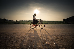 On the way to school. 7.42am (freebird) Tags: school shadow bicycle sunrise khmer sony fe f4 kampuchea 1635mm kampongchhnang